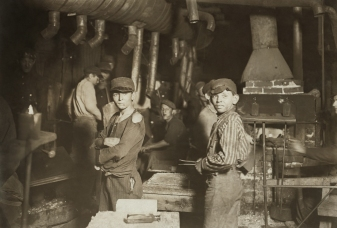 Child workers at glass factory in Indiana, 1908. American muckrakers in early 20th Century helped bring about labor reforms. (Photo by Louis HInes/Library of Congress)